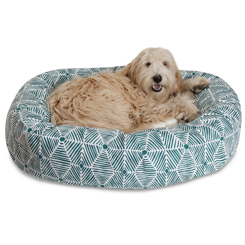 Sheepdog laying on a Majestic Pet Sherpa Bagel Dog Bed.